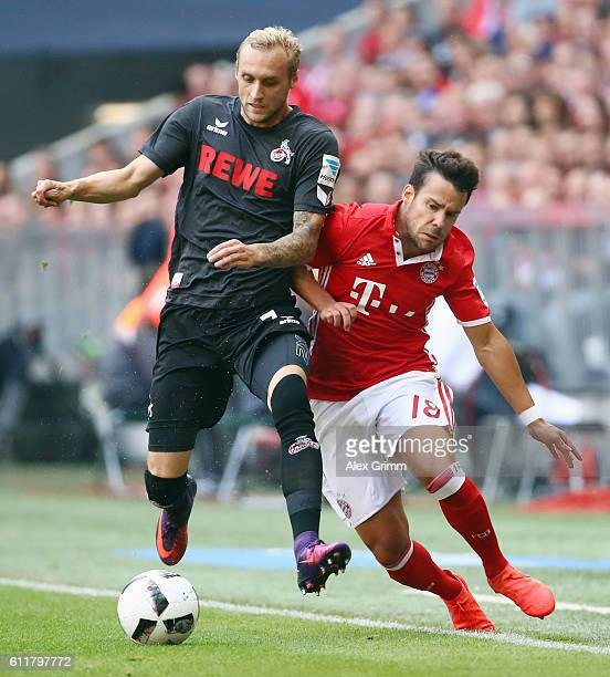 Marcel Risse of Koeln is challenged by Juan Bernat of Muenchen during the Bundesliga match between Bayern Muenchen and 1 FC Koeln at Allianz Arena on...