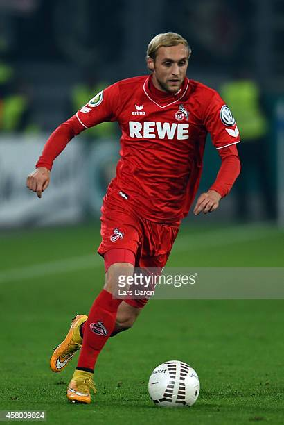 Marcel Risse of Koeln runs with the ball during the DFB Cup second round match between MSV Duisburg and 1 FC Koeln at SchauinslandReisenArena on...