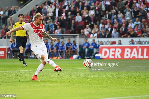 Marcel Risse of Koeln scores her team's first goal during the Bundesliga match between 1 FC Koeln and FC Schalke 04 at RheinEnergieStadion on May 10...