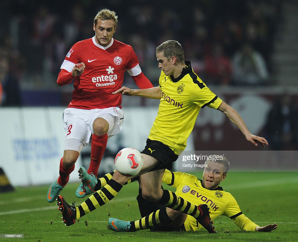 <a gi-track='captionPersonalityLinkClicked' href=/galleries/search?phrase=Marcel+Risse&family=editorial&specificpeople=4331527 ng-click='$event.stopPropagation()'>Marcel Risse</a> of Mainz (L) is challenged by <a gi-track='captionPersonalityLinkClicked' href=/galleries/search?phrase=Sven+Bender&family=editorial&specificpeople=596822 ng-click='$event.stopPropagation()'>Sven Bender</a> of Dortmund (C) and <a gi-track='captionPersonalityLinkClicked' href=/galleries/search?phrase=Jakub+Blaszczykowski&family=editorial&specificpeople=2290714 ng-click='$event.stopPropagation()'>Jakub Blaszczykowski</a> of Dortmund during the Bundesliga match between 1. FSV Mainz 05 and Borussia Dortmund at Coface Arena on November 24, 2012 in Mainz, Germany.
