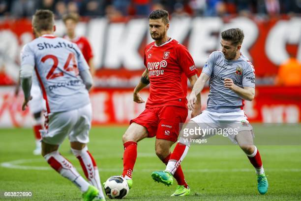 Marcel Ritzmaaier of Go Ahead Eagles Mateusz Klich of FC Twente Daniel Crowley of Go Ahead Eaglesduring the Dutch Eredivisie match between FC Twente...