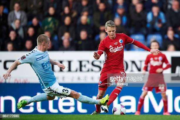 Marcel Romer of Sonderjyske and Kasper Kusk of FC Copenhagen compete for the ball during the Danish Alka Superliga match between Sonderjyske and FC...
