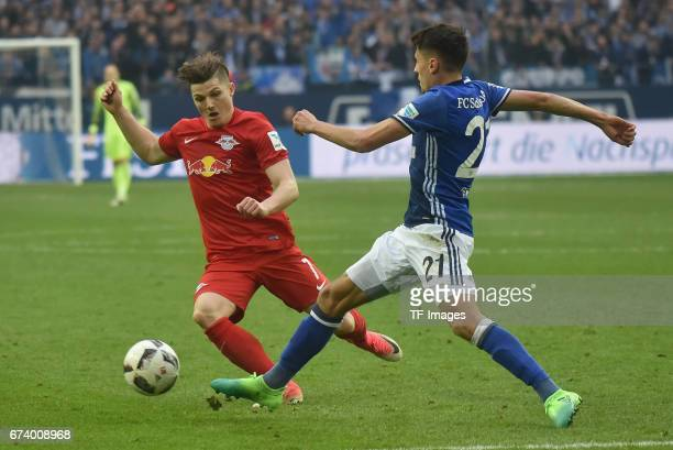 Marcel Sabitzer of Leipzig and Bernard Tekpetey of Schalke battle for the ball during the Bundesliga match between FC Schalke 04 and RB Leipzig at...