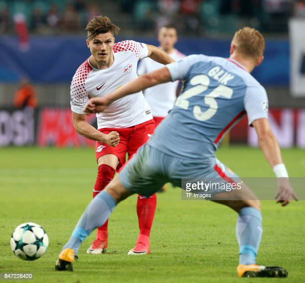 Marcel Sabitzer of Leipzig and Kamil Glik of Monaco battle for the ball during the UEFA Champions League group G match between RB Leipzig and AS...
