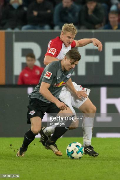 Marcel Sabitzer of Leipzig and Martin Hinteregger of Augsburg battle for the ball during the Bundesliga match between FC Augsburg and RB Leipzig at...