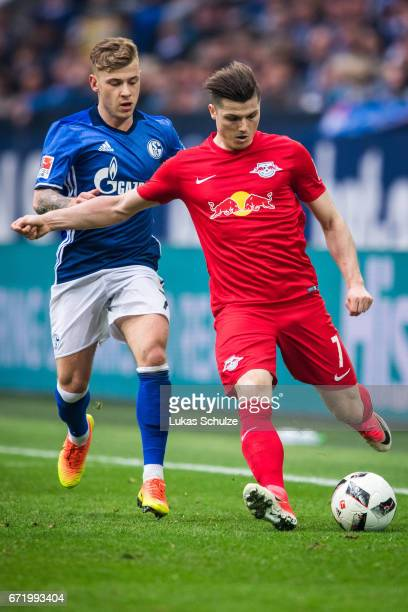 Marcel Sabitzer of Leipzig and Max Meyer of Schalke in action during the Bundesliga match between FC Schalke 04 and RB Leipzig at VeltinsArena on...