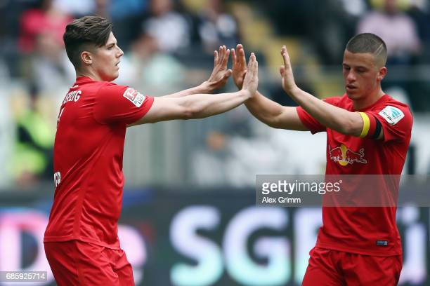 Marcel Sabitzer of Leipzig celebrates his team's first goal with team mate Diego Demme during the Bundesliga match between Eintracht Frankfurt and RB...