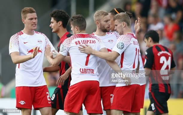 Marcel Sabitzer of Leipzig celebrates his team's first goal with team mates during the DFB Cup first round match between Sportfreunde Dorfmerkingen...