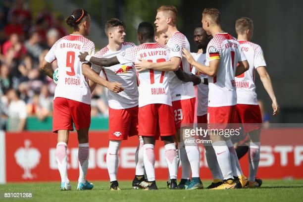 Marcel Sabitzer of Leipzig celebrates his team's second goal with team mates during the DFB Cup first round match between Sportfreunde Dorfmerkingen...
