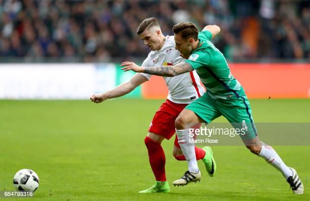 Marcel Sabitzer of Leipzig is challenged by Robert Bauer of Bremen during the Bundesliga match between Werder Bremen and RB Leipzig at Weserstadion...