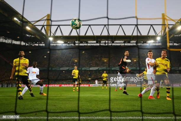 Marcel Sabitzer of Leipzig scores a goal past goalkeeper Roman Buerki of Dortmund to make it 11 during the Bundesliga match between Borussia Dortmund...