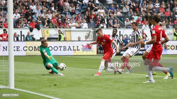 Marcel Sabitzer of Leipzig scores his team's first goal past goalkeeper Lukas Hradecky of Frankfurt during the Bundesliga match between Eintracht...