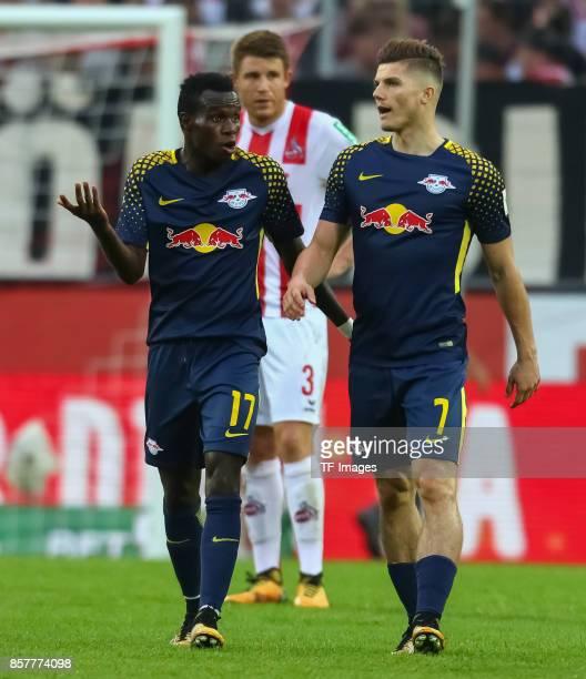 Marcel Sabitzer of Leipzig speak with Armindo Tue Na Bangna during the Bundesliga match between 1 FC Koeln and RB Leipzig at RheinEnergieStadion on...