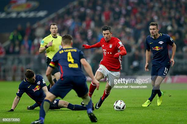 Marcel Sabitzer of RB Leipzig and Robert Lewandowski of Bayern Muenchen battle for possessionduring the Bundesliga match between Bayern Muenchen and...