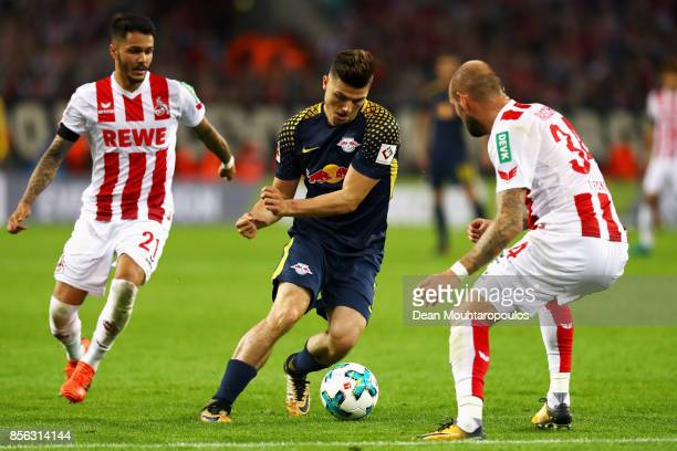 Marcel Sabitzer of RB Leipzig battles for the ball with Konstantin Rausch and Leonardo Bittencourt of FC Koeln during the Bundesliga match between 1...