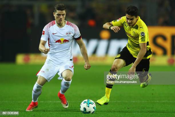 Marcel Sabitzer of RB Leipzig battles for the ball with Marc Bartra of Borussia Dortmund during the Bundesliga match between Borussia Dortmund and RB...
