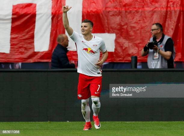 Marcel Sabitzer of RB Leipzig celebrates after scoring his team's first goal during the Bundesliga match between RB Leipzig and Bayern Muenchen at...