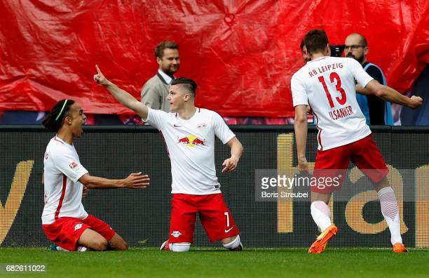 Marcel Sabitzer of RB Leipzig celebrates with team mates after scoring his team's first goal during the Bundesliga match between RB Leipzig and...
