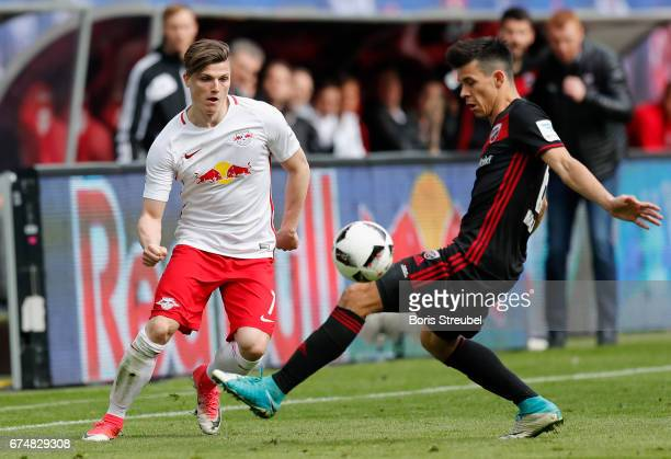 Marcel Sabitzer of RB Leipzig is challenged by Alfredo Morales of FC Ingolstadt 04 during the Bundesliga match between RB Leipzig and FC Ingolstadt...