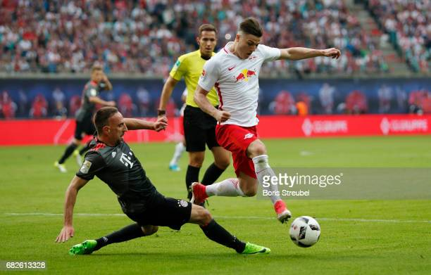 Marcel Sabitzer of RB Leipzig is challenged by Franck Ribery of FC Bayern Muenchen during the Bundesliga match between RB Leipzig and Bayern Muenchen...