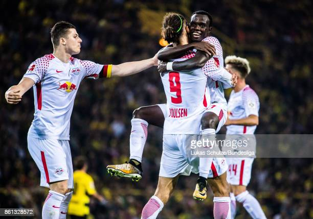 Marcel Sabitzer Yussuf Poulsen and Bruma of Leipzig celebrate their teams second goal during the Bundesliga match between Borussia Dortmund and RB...