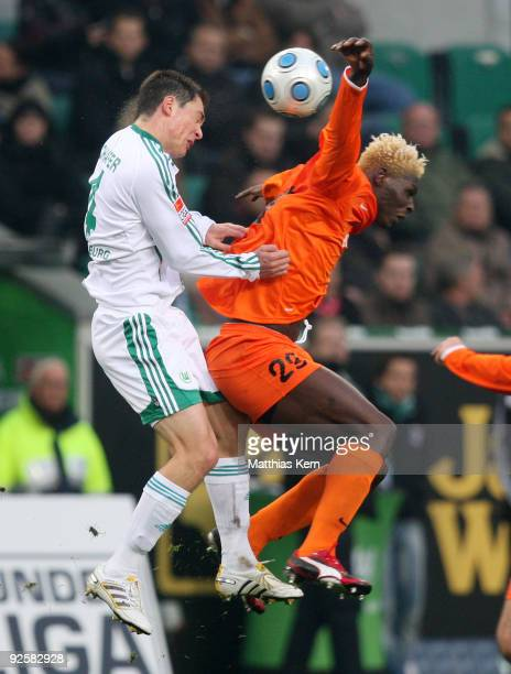 Marcel Schaefer of Wolfsburg and Aristide Bance of Mainz jump for a header during the Bundesliga match between VFL Wolfsburg and FSV Mainz 05 at the...