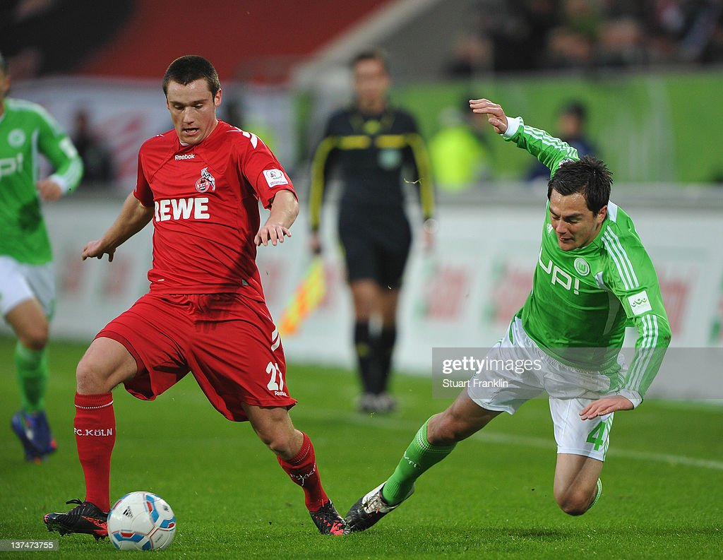 <a gi-track='captionPersonalityLinkClicked' href=/galleries/search?phrase=Marcel+Schaefer&family=editorial&specificpeople=656515 ng-click='$event.stopPropagation()'>Marcel Schaefer</a> of Wolfsburg is challenged by Christian Clemens of Koeln during the Bundesliga match between VfL Wolfsburg and 1. FC Koeln at Volkswagen Arena on January 21, 2012 in Wolfsburg, Germany.