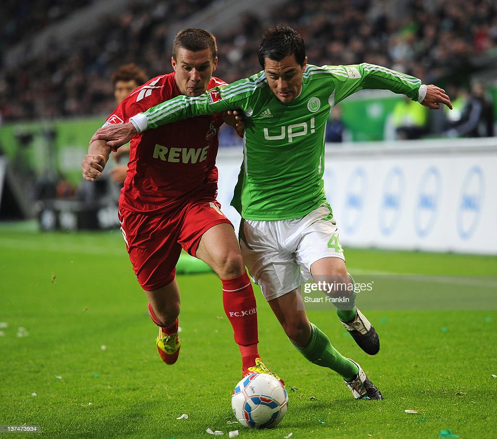 <a gi-track='captionPersonalityLinkClicked' href=/galleries/search?phrase=Marcel+Schaefer&family=editorial&specificpeople=656515 ng-click='$event.stopPropagation()'>Marcel Schaefer</a> of Wolfsburg is challenged by <a gi-track='captionPersonalityLinkClicked' href=/galleries/search?phrase=Lukas+Podolski&family=editorial&specificpeople=204460 ng-click='$event.stopPropagation()'>Lukas Podolski</a> of Koeln during the Bundesliga match between VfL Wolfsburg and 1. FC Koeln at Volkswagen Arena on January 21, 2012 in Wolfsburg, Germany.