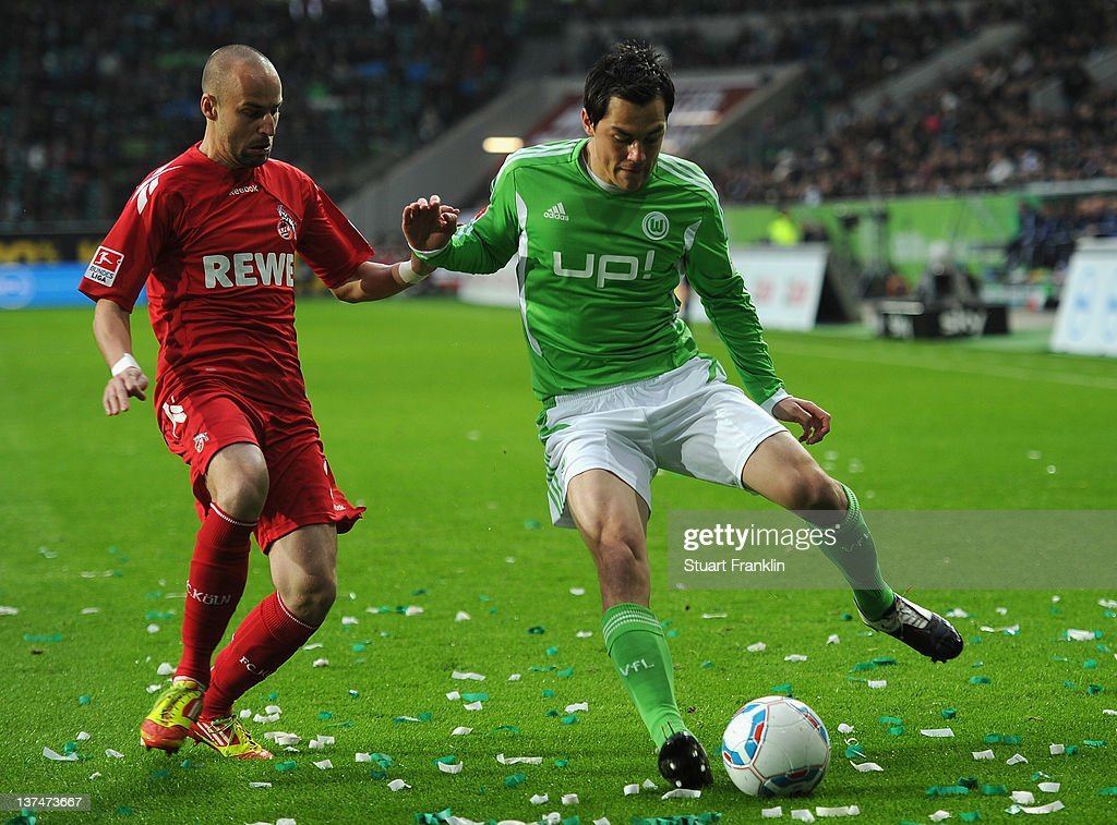 <a gi-track='captionPersonalityLinkClicked' href=/galleries/search?phrase=Marcel+Schaefer&family=editorial&specificpeople=656515 ng-click='$event.stopPropagation()'>Marcel Schaefer</a> of Wolfsburg is challenged by <a gi-track='captionPersonalityLinkClicked' href=/galleries/search?phrase=Miso+Brecko&family=editorial&specificpeople=708716 ng-click='$event.stopPropagation()'>Miso Brecko</a> of Koeln during the Bundesliga match between VfL Wolfsburg and 1. FC Koeln at Volkswagen Arena on January 21, 2012 in Wolfsburg, Germany.