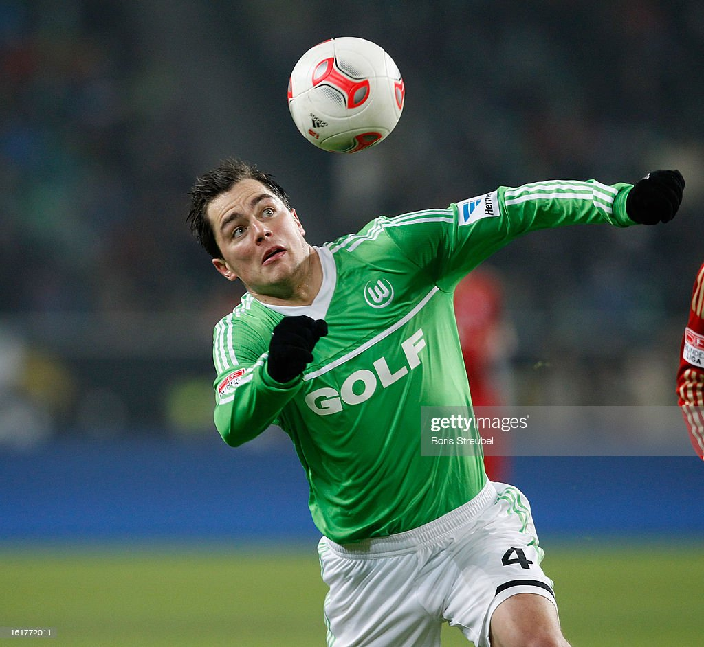 <a gi-track='captionPersonalityLinkClicked' href=/galleries/search?phrase=Marcel+Schaefer&family=editorial&specificpeople=656515 ng-click='$event.stopPropagation()'>Marcel Schaefer</a> of Wolfsburg jumps for a header during the Bundesliga match between VFL Wolfsburg and FC Bayern Muenchen at Volkswagen Arena on February 15, 2013 in Wolfsburg, Germany.