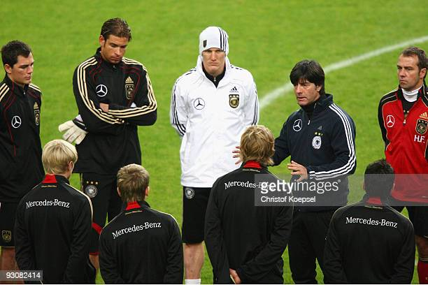 Marcel Schaefer Tim Wiese Bastian Schweinsteiger national coach Joachim Loew and assistant coach Hansi Flick come together during a German National...