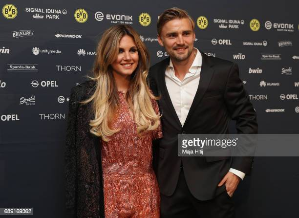 Marcel Schmelzer and his wife Jenny arrive for the Borussia Dortmund champions party at the Grand Hyatt Hotel following their DFB Cup Final victory...