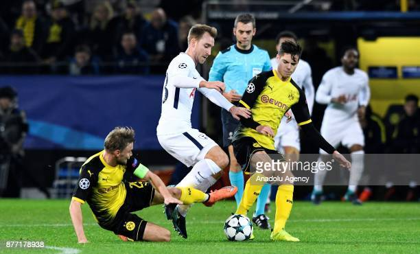 Marcel Schmelzer and Julian Weigl of Dortmund in action against Christian Eriksen of Tottenham Hotspur FC during the UEFA Champions League Group H...