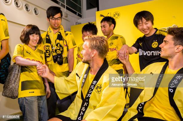 Marcel Schmelzer and Marc Bartra of Borussia Dortmund together with their fans during the KAMO activity event at the PUMA Brand Center Tokyo on July...