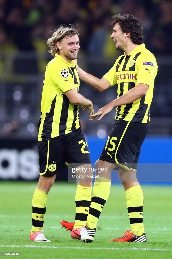 Marcel Schmelzer and Mats Hummels of Dortmund celebrate the 1-0 vicztory after the UEFA Champions League group D match between Borussia Dortmund and Ajax Amsterdam at Signal Iduna Park on September 18, 2012 in Dortmund, Germany.
