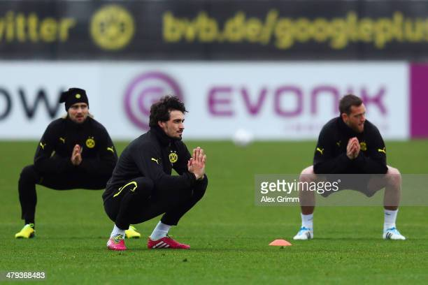 Marcel Schmelzer Mats Hummels and Julian Schieber exercise during a Borussia Dortmund training session ahead of their UEFA Chamions League Round of...