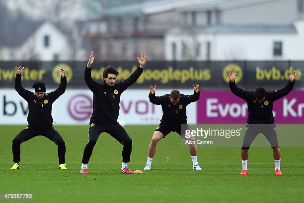 Marcel Schmelzer Mats Hummels Julian Schieber and Nuri Sahin exercise during a Borussia Dortmund training session ahead of their UEFA Chamions League...