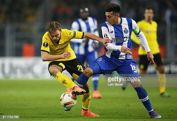 Marcel Schmelzer of Borussia Dortmund and Hector Herrera of FC Porto compete for the ball during the UEFA Europa League round of 32 first leg match...