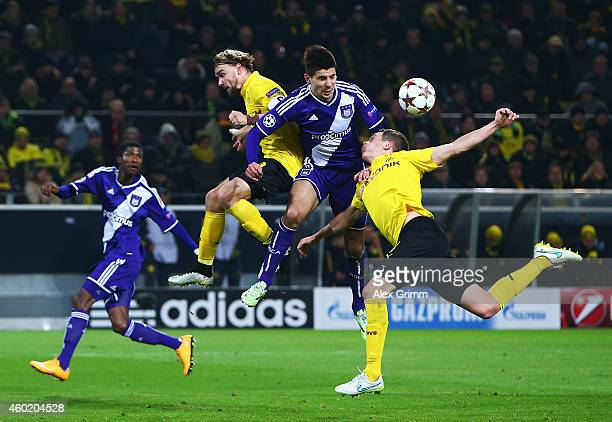Marcel Schmelzer of Borussia Dortmund and Matthias Ginter of Borussia Dortmund challenge for the ball with Aleksandar Mitrovic of Anderlecht during...