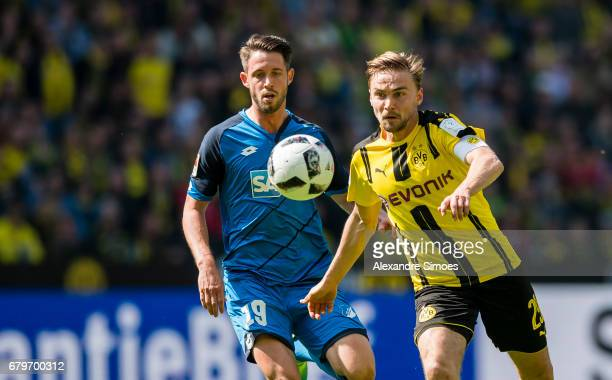 Marcel Schmelzer of Borussia Dortmund battle for the ball against MarkAlexander Uth of TSG Hoffenheim during the Bundesliga match between Borussia...