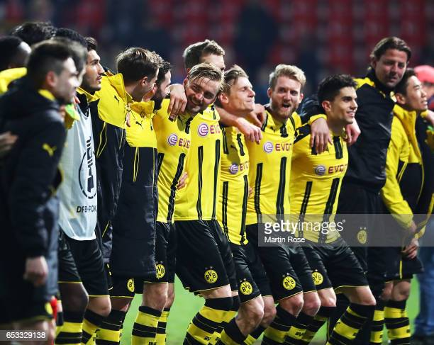 Marcel Schmelzer of Borussia Dortmund celebrates with team mates after victory in the DFB Cup quarter final between Sportfreunde Lotte and Borussia...