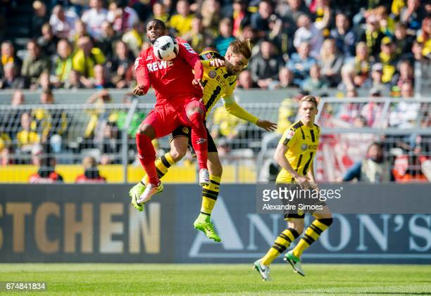 Marcel Schmelzer of Borussia Dortmund challenges Anthony Modeste of 1 FC Koeln during the Bundesliga match between Borussia Dortmund and FC Koeln at...
