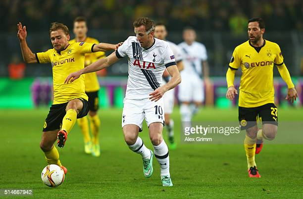 Marcel Schmelzer of Borussia Dortmund holds off Harry Kane of Tottenham Hotspur during the UEFA Europa League Round of 16 first leg match between...