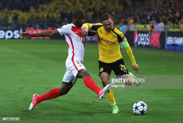 Marcel Schmelzer of Borussia Dortmund is closed down by Almamy Toure of AS Monaco during the UEFA Champions League Quarter Final first leg match...
