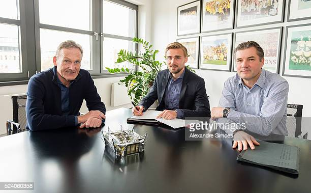 Marcel Schmelzer of Borussia Dortmund with HansJoachim Watzke and Michael Zorc as he renews Contract Until 2021 for Borussia Dortmund on April 25...