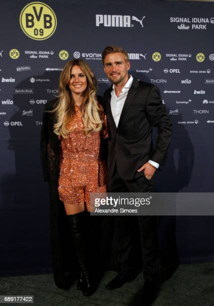 Marcel Schmelzer of Borussia Dortmund with his wife on the red carpet prior to the Borussia Dortmund Champions Party on May 27 2017 in Berlin Germany