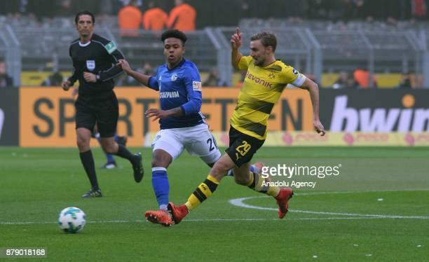 Marcel Schmelzer of Dortmund against Weston McKennie of Schalke during Bundesliga soccer match between Borussia Dortmund and FC Schalke 04 at the...