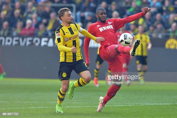 Marcel Schmelzer of Dortmund and Anthony Modeste of Colonge battle for the ball during the Bundesliga match between Borussia Dortmund and FC Koeln at...