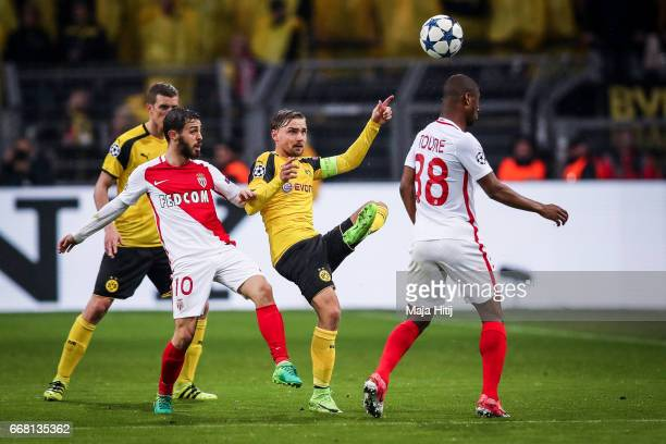 Marcel Schmelzer of Dortmund and Bernardo Silva of Monaco fight for the ball during the UEFA Champions League Quarter Final first leg match between...