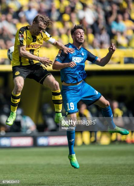 Marcel Schmelzer of Dortmund and Mark Alexander Uth of Hoffenheim battle for the ball the Bundesliga match between Borussia Dortmund and TSG 1899...